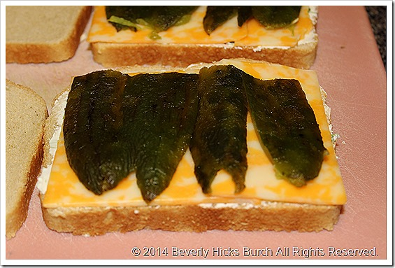Add peppers to sandwich