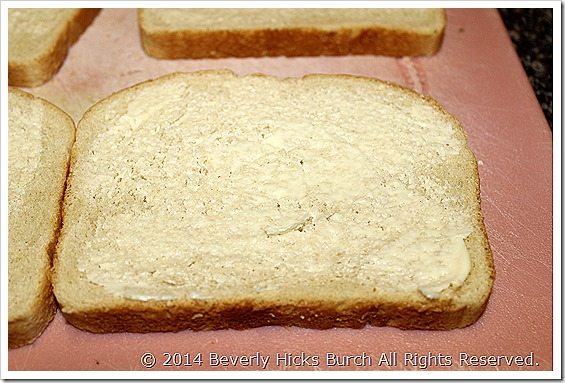 Lightly spread butter onto bread